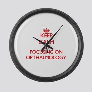 Keep Calm by focusing on Opthalmo Large Wall Clock