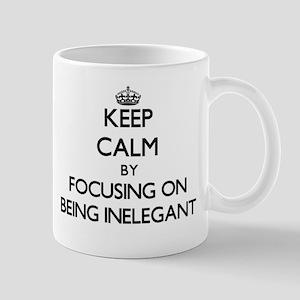 Keep Calm by focusing on Being Inelegant Mugs