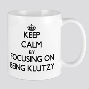 Keep Calm by focusing on Being Klutzy Mugs