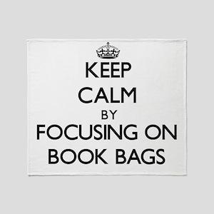 Keep Calm by focusing on Book Bags Throw Blanket