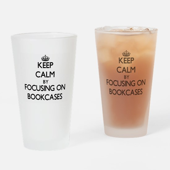 Keep Calm by focusing on Bookcases Drinking Glass