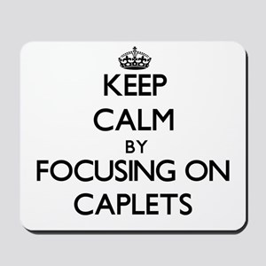 Keep Calm by focusing on Caplets Mousepad