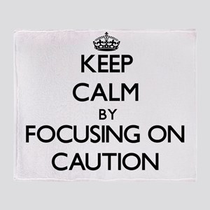Keep Calm by focusing on Caution Throw Blanket