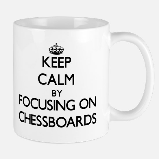 Keep Calm by focusing on Chessboards Mugs