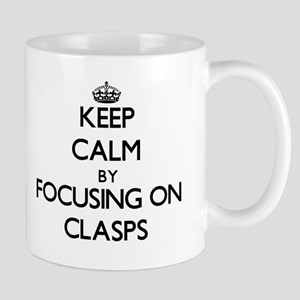 Keep Calm by focusing on Clasps Mugs