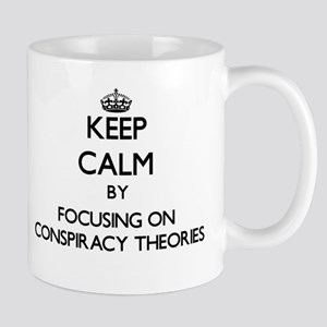 Keep Calm by focusing on Conspiracy Theories Mugs