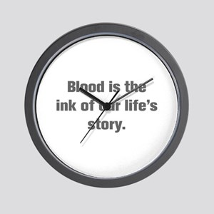 Blood is the ink of our life s story Wall Clock
