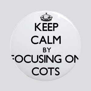 Keep Calm by focusing on Cots Ornament (Round)