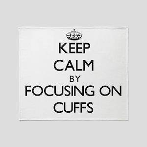 Keep Calm by focusing on Cuffs Throw Blanket