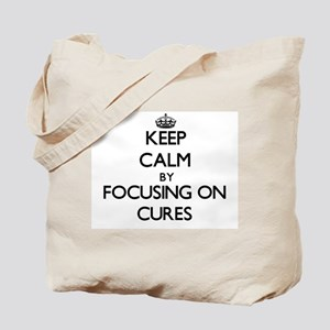 Keep Calm by focusing on Cures Tote Bag