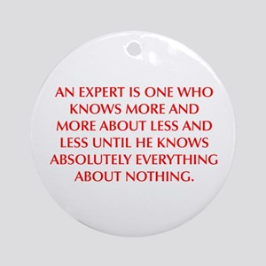 AN EXPERT IS ONE WHO KNOWS MORE AND MORE ABOUT LES