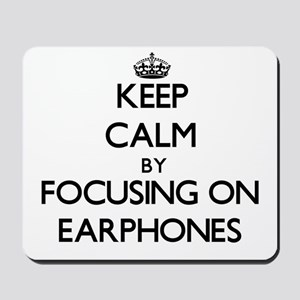 Keep Calm by focusing on EARPHONES Mousepad