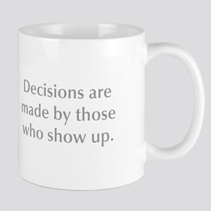 Decisions are made by those who show up Mugs