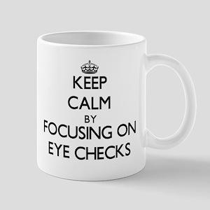 Keep Calm by focusing on EYE CHECKS Mugs