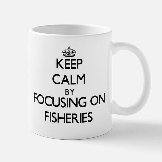 Keep Calm by focusing on Fisheries Mugs