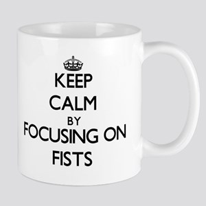 Keep Calm by focusing on Fists Mugs