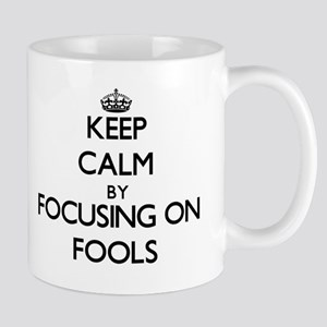 Keep Calm by focusing on Fools Mugs