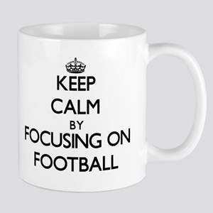 Keep Calm by focusing on Football Mugs