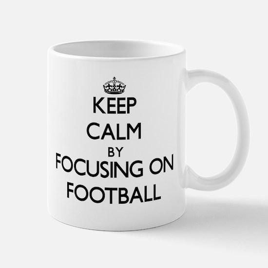 Keep Calm by focusing on Football Mugs