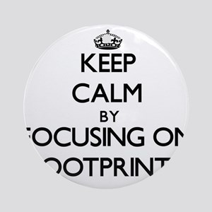 Keep Calm by focusing on Footprin Ornament (Round)