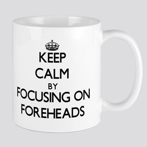 Keep Calm by focusing on Foreheads Mugs