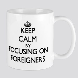 Keep Calm by focusing on Foreigners Mugs