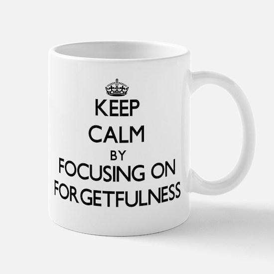 Keep Calm by focusing on Forgetfulness Mugs