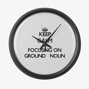 Keep Calm by focusing on Ground Large Wall Clock