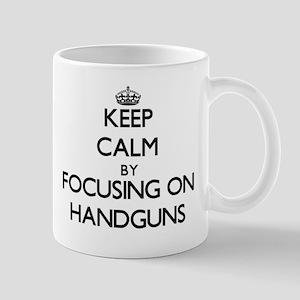 Keep Calm by focusing on Handguns Mugs