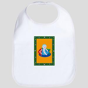 baby in turban by pillows Bib