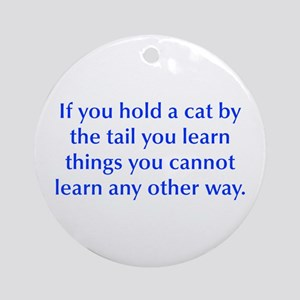 If you hold a cat by the tail you learn things you