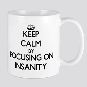 Keep Calm by focusing on Insanity Mugs