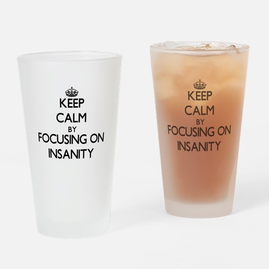 Keep Calm by focusing on Insanity Drinking Glass