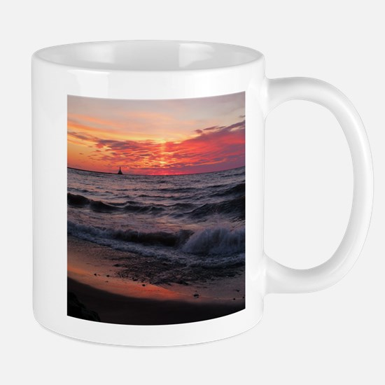 Sunset with waves Mugs