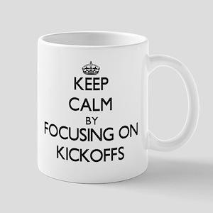 Keep Calm by focusing on Kickoffs Mugs