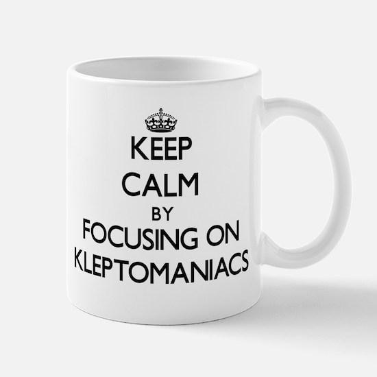 Keep Calm by focusing on Kleptomaniacs Mugs