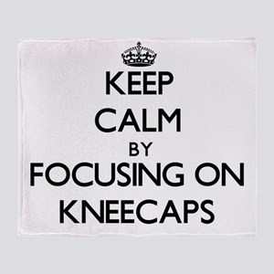 Keep Calm by focusing on Kneecaps Throw Blanket