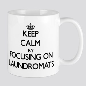 Keep Calm by focusing on Laundromats Mugs