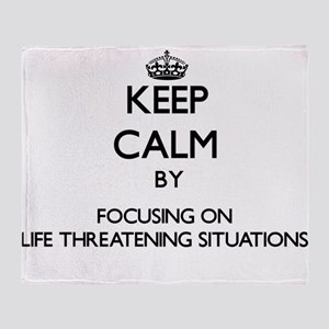 Keep Calm by focusing on Life Threat Throw Blanket