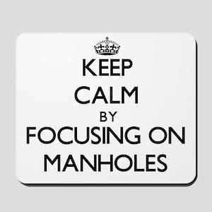 Keep Calm by focusing on Manholes Mousepad