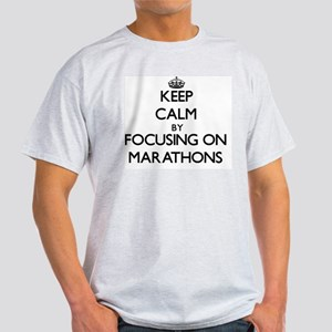 Keep Calm by focusing on Marathons Light T-Shirt