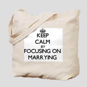 Keep Calm by focusing on Marrying Tote Bag
