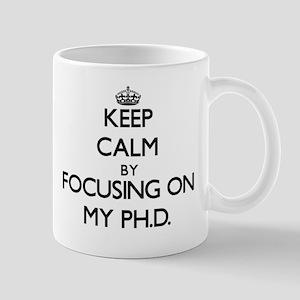 Keep Calm by focusing on My Ph.D. Mugs