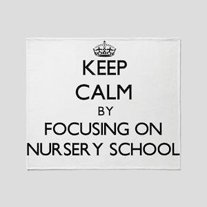 Keep Calm by focusing on Nursery Sch Throw Blanket