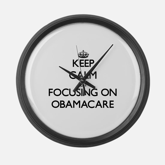 Keep Calm by focusing on Obamacar Large Wall Clock