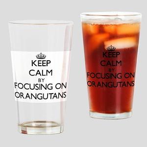 Keep Calm by focusing on Orangutans Drinking Glass