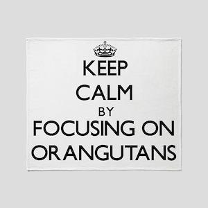 Keep Calm by focusing on Orangutans Throw Blanket