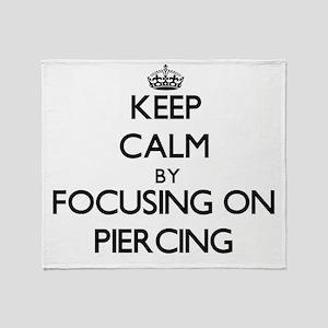 Keep Calm by focusing on Piercing Throw Blanket