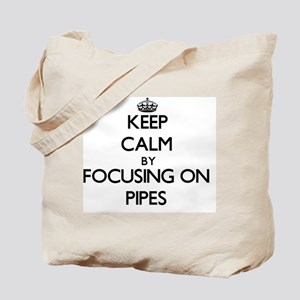 Keep Calm by focusing on Pipes Tote Bag