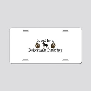 Loved by a doberman pinascher Aluminum License Pla